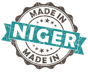 made in niger turquoise grungy scratched seal isolated on white