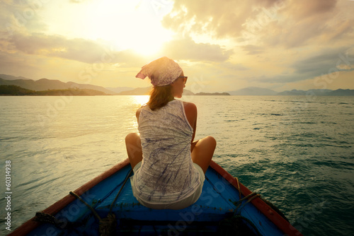 Fotobehang Water Motorsp. Woman traveling by boat at sunset among the islands.