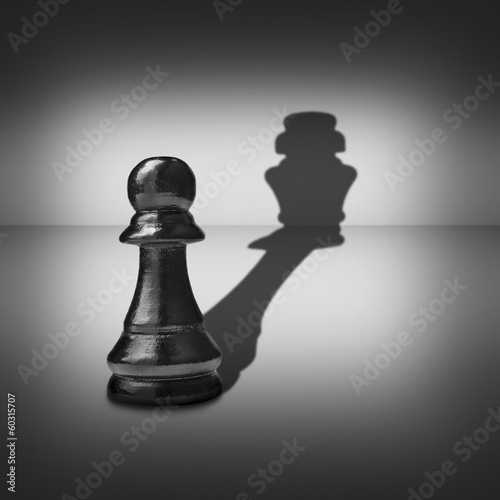 Dual identity with a pawn casting a king shadow