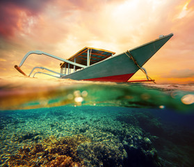 Diving boat at sunset