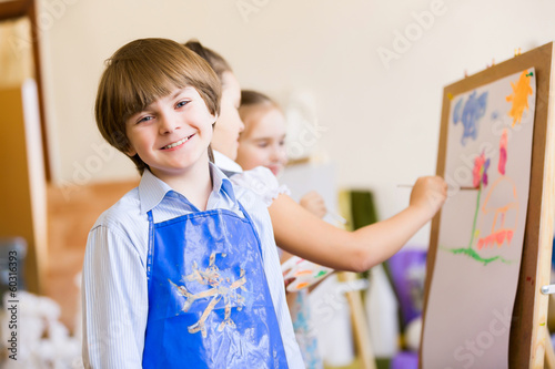 Cute boy painting