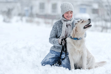 Portrait of a boy with a dog on a winter day