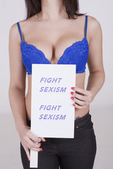 Portrait of a young woman holding Fight Sexism slogan