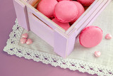 pink macarons in box and little hearts. Selective focus