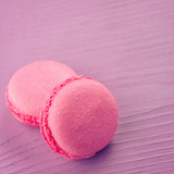 pink macarons on rose background. Toned and selective focus