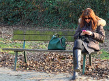 woman on the bench while using your mobile phone