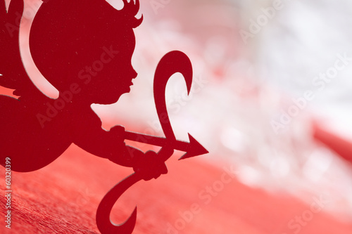 cupid on red background