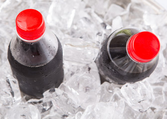 Cola drinks cooled with ice cubes