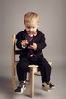 little cute businessman with mobile phone