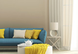 Light interior with blue sofa
