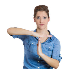 Serious woman showing a time out gesture with hands