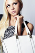 Fashionable Beautiful Blond Woman with White Handbag