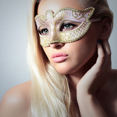 Beautiful Blond Woman in Carnival Mask.Masquerade