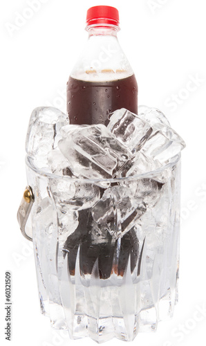 A bottle of cola drink cooled with ice cubes