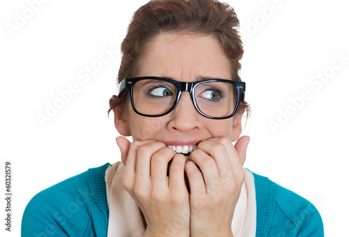 Stressed, anxious young woman biting fingernails