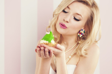 Frog prince being kissed by a beautiful glamour woman