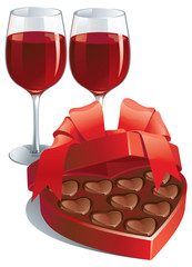 two wineglasses and heart shaped box of chocolates candy