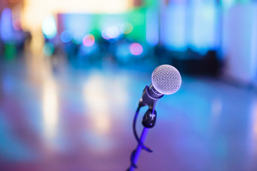 Microphone with blurred party stage around