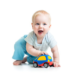 funny boy kid playing with toy car