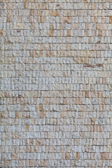 Wall with small grey granite tiles