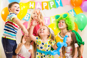 children celebrating  .merrily birthday party