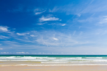 Sand beach, calm sea and blue sky, copy space