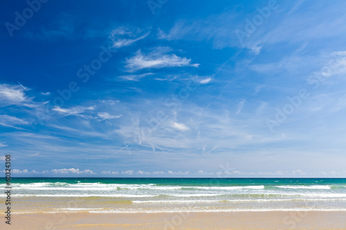 Sand beach, calm sea and blue sky, copy space