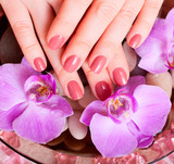 Beautiful Manicure and Pedicure in spa salon.