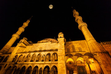 Exterior of Blue mosque at night with full moon