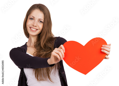Beautiful girl with a red heart in the hands