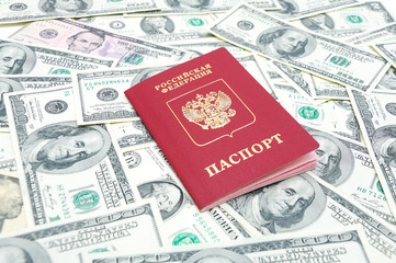 Russian passport on U.S. dollars background
