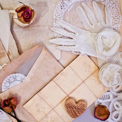 Women's white gloves and old letters. Vintage items