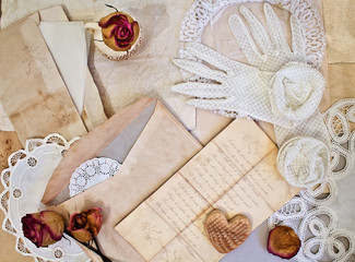Women's white gloves and old letters.