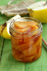 quince jam confiture in glass jar on a wooden table