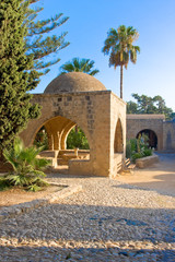 Octagonal fountain in courtyard of monastery. Ayia Napa, Cyprus