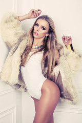 sexy girl with blond hair in fur coat
