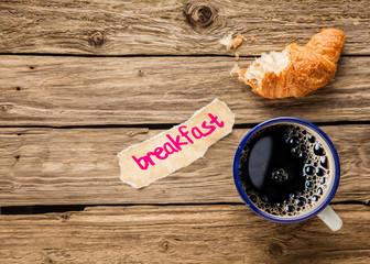 Breakfast - a half eaten croissant with espresso