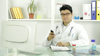 Handsome Young Doctor Texting Smiling Cellphone
