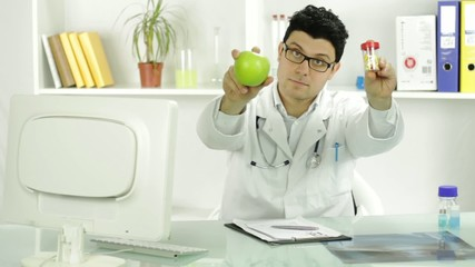 Young Doctor Holding Apple and Pills Fruit and Medicine Concept