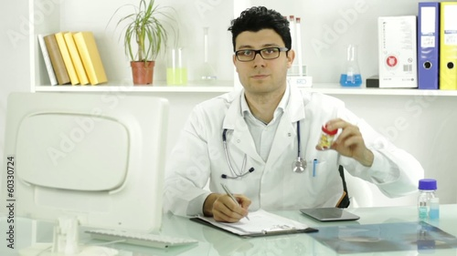 Doctor Medical Professional Writing Prescription Showing Pills