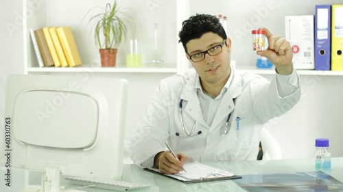 Handsome Young Doctor Offering Pills Smiling Prescribing Concept