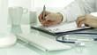 Hand doctor pen writing on rx prescription blank