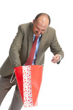 Businessman and red paper bag