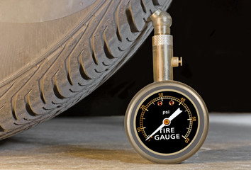 Car tire pressure gauge and tire sidewall