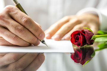 Romantic man writing a love letter