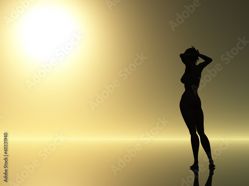 Female silhouette against sunrise
