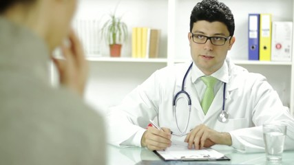 Doctor Consulting Patient Bad News Concept