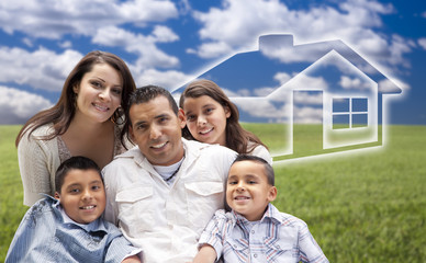 Hispanic Family Sitting in Grass Field with Ghosted House Behind