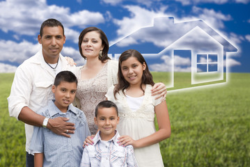 Hispanic Family Standing in Grass Field with Ghosted House Behin