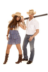 cowboy with gun and cowgirl